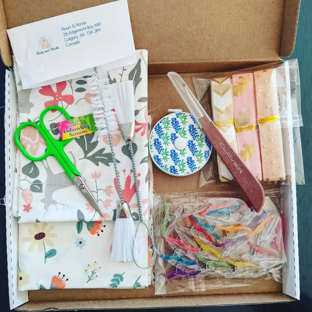 I just received my free giveaway gift from @floursandflorals, Calgary, Alberta. Thanks bunches! Lovely goodies: embroidery scissors, tape measure, mini quilter's clips, Clover seam ripper, decorative elastics,  machine cleaning