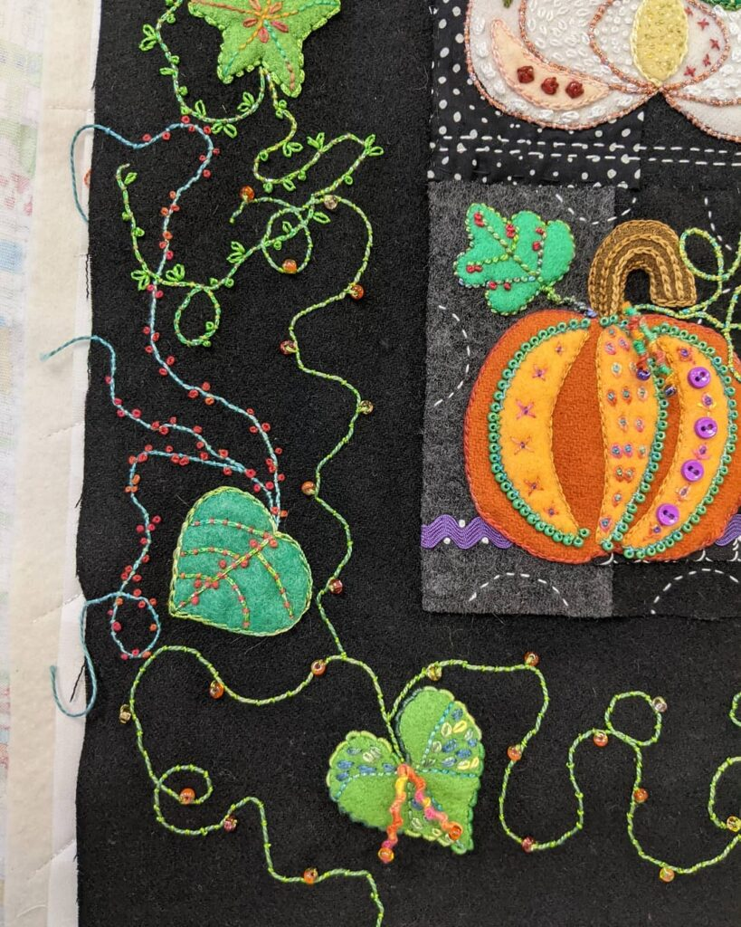 Another part of Squash Squad border. I think it's done!! The hand embroidery, that is.  #jctextileart #pinegrovenovascotia #suespargo #squashsquad #squash #suespargothreads #valdanithreads #glassbeads #beading #woolapplique #lockdownembroidery #madebyhand #madeinns #embroiderystitches #embroderyartwork