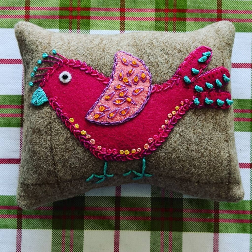 Not my work but that of my NL friend, J2. Due to Covid, she didn't get out to mail this little gift to me. I told her it is now my new favorite pincushion!! I just love it!!!  #jctextileart #pinegrovenovascotia #suespargoinspired #pincushion #woolapplique #woolembellishment #feltembellishments #handembroidered #woolflannel #gift #madeinnl #friendsforever #bestfriends