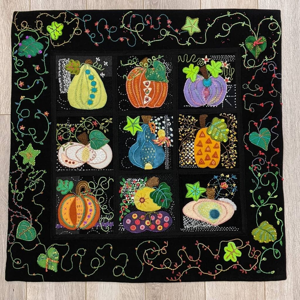 Squash Squad is finally finished and ready to hang. I made a facing binding with sleeves top and bottom. This was a free, 9 week project from @suespargo. Thanks Sue. I thoroughly enjoyed stitching it. I did go a bit overboard with my vine border but I like it. Lots of different threads were used on this one  #jctextileart #pinegrovenovascotia #squashsquad #suespargo #suespargothreads #dmcthreads #cosmosthreads #valdanithreads #silkribbon #glassbeads #miniaturebuttons #buttons #handembroidered #woolapplique #surfaceembellishment #woolfelt #autumnproject #squash #vines